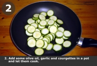 Add some olive oil, garlic and courgettes in a pot and let them cook.